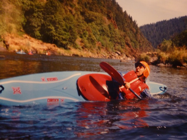Marion learning how to Eskimo Roll the kayak
