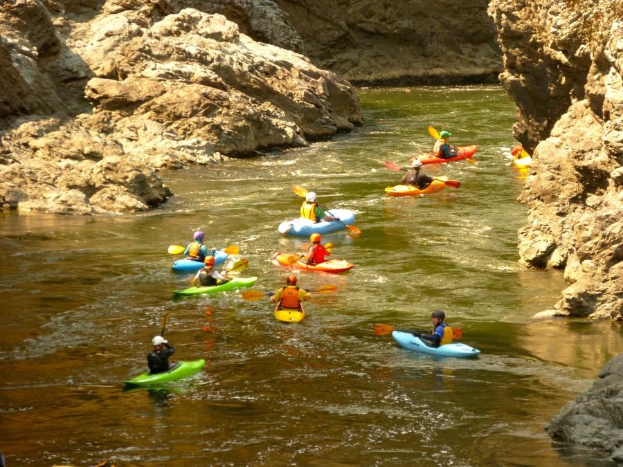 Kayaker paddling through Mule Creek Canyon